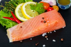 Salted salmon fillet. With spices royalty free stock photo