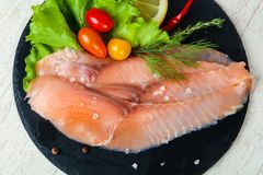 Salted salmon fillet. With spices royalty free stock photography