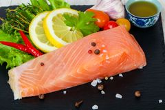 Salted salmon fillet. With spices stock image
