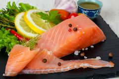 Salted salmon fillet. With spices royalty free stock images