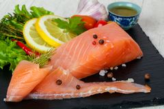 Salted salmon fillet. With spices stock images