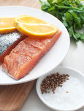 Salted salmon fillets with oranges Stock Photo