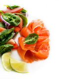 Salted salmon with fresh green salad and lime Royalty Free Stock Image