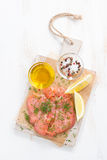 Salted salmon and ingredients on a wooden board, top view Royalty Free Stock Photos