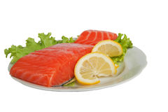 Salted salmon with lemon on salad leaves Stock Image