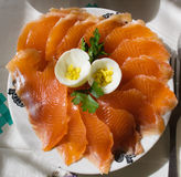 Salted salmon on the plate. With eggs Royalty Free Stock Photography