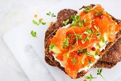 Salted salmon, red caviar, avocado and cream cheese rye crisp. Toast stock photography