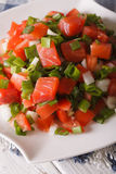 Salted salmon salad with tomatoes and green onions close-up. ver Stock Photo