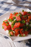 Salted salmon salad with vegetables close-up. Vertical Royalty Free Stock Image