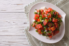 Salted salmon salad with vegetables. Horizontal top view Royalty Free Stock Photo