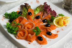 Salted salmon sliced on a plate Royalty Free Stock Image
