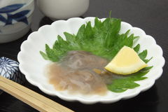 Salted Sea Cucumber Guts and Japanese rice wine `Sake` Stock Photography