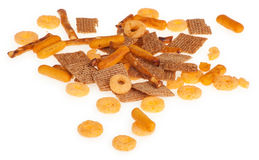Salted Snack Mix Close up. This is a mix of salted pretzels, cereal squares and cheezy bread crisps isolated on white stock image