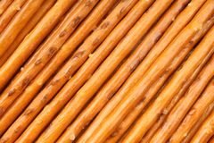 Salted sticks. In a diagonal lines arranged as a background Royalty Free Stock Image