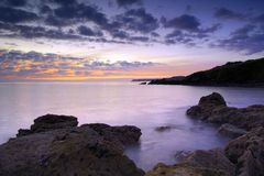 Saltern Cove before sunrise. Beautiful pre-dawn light at Saltern Cove near Paignton South Devon royalty free stock images