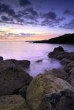 Saltern Cove before sunrise. Beautiful pre-dawn light at Saltern Cove near Paignton South Devon royalty free stock photography