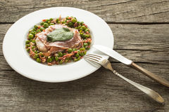 Saltimbocca alla Romana with peas Royalty Free Stock Photos