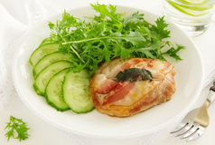 Saltimbocca. With cucumber salad and mint Stock Photo
