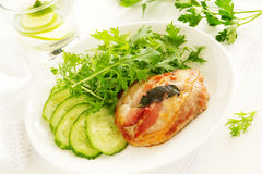 Saltimbocca with cucumber salad. Selective focus Royalty Free Stock Images