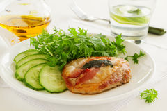 Saltimbocca with cucumber salad. Stock Photography