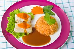 Saltimbocca with fried rice Stock Images