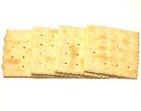 Saltine crackers. Closeup of saltine cracker on white background Royalty Free Stock Photos