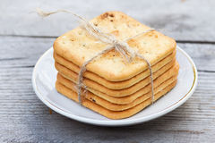 Saltine crackers on a plate on white table Stock Photo