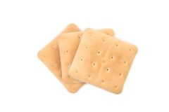 Saltine soda cracker isolated on white. Royalty Free Stock Images