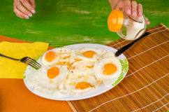 Salting eggs Stock Image