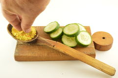 Salting fresh cucumber Royalty Free Stock Image