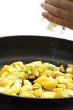 Salting fried potatoes, close-up Royalty Free Stock Image