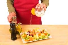 Salting a salad Stock Images