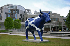 Saltire Cow - Scottish Parliament. The 'Cow Parade' is an international public art exhibition that has been held in many international cities Royalty Free Stock Images