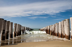 Saltland. Wavebreakers at Zoutelande Beach, the Netherlands during a nice summer afternoon. Zoutelande beach is a well known beach in the Netherlands with its Royalty Free Stock Photo