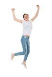 Salto adolescente de la muchacha Foto de archivo libre de regalías
