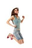 Salto adolescente de la muchacha alegre Imagen de archivo libre de regalías