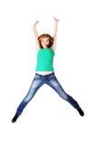 Salto adolescente dell'allievo. Fotografie Stock Libere da Diritti