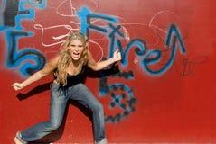 Salto adolescente feliz Imagen de archivo