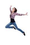 Salto adolescente feliz de la muchacha Imagen de archivo libre de regalías