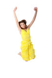 Salto adolescente sonriente de la muchacha de los jóvenes Foto de archivo libre de regalías