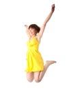 Salto adolescente sonriente de la muchacha de los jóvenes Imagen de archivo libre de regalías