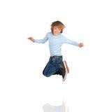 Salto adorable del niño fotos de archivo