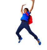 Salto afro-americano entusiasmado do menino de escola Imagem de Stock Royalty Free