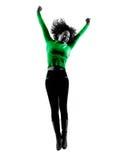 Salto aislado silueta de la mujer feliz Foto de archivo