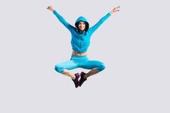 Salto alegre de la muchacha Imagenes de archivo