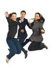 Salto alegre dos trabalhos de equipa Foto de Stock Royalty Free