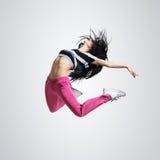 Salto atletico di dancing della ragazza Fotografia Stock