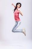 Salto atractivo de la chica joven Fotos de archivo