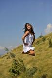 Salto bonito da menina Foto de Stock Royalty Free