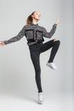Salto bonito de la muchacha Imagen de archivo